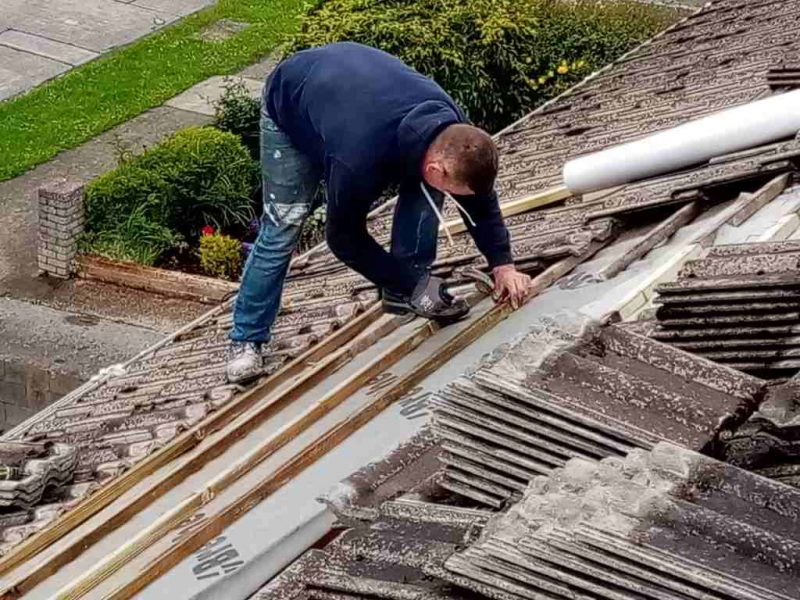 Relaying the tiles on a roof in Dublin